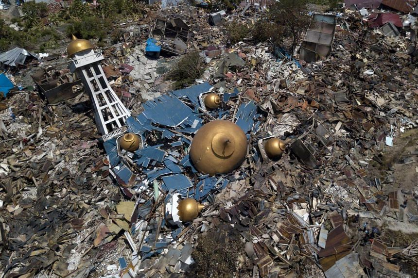 An aerial photo showing a mosque and surrounding structures in Palu, Central Sulawesi, that had been destroyed by an earthquake, on Sept 30, 2018.