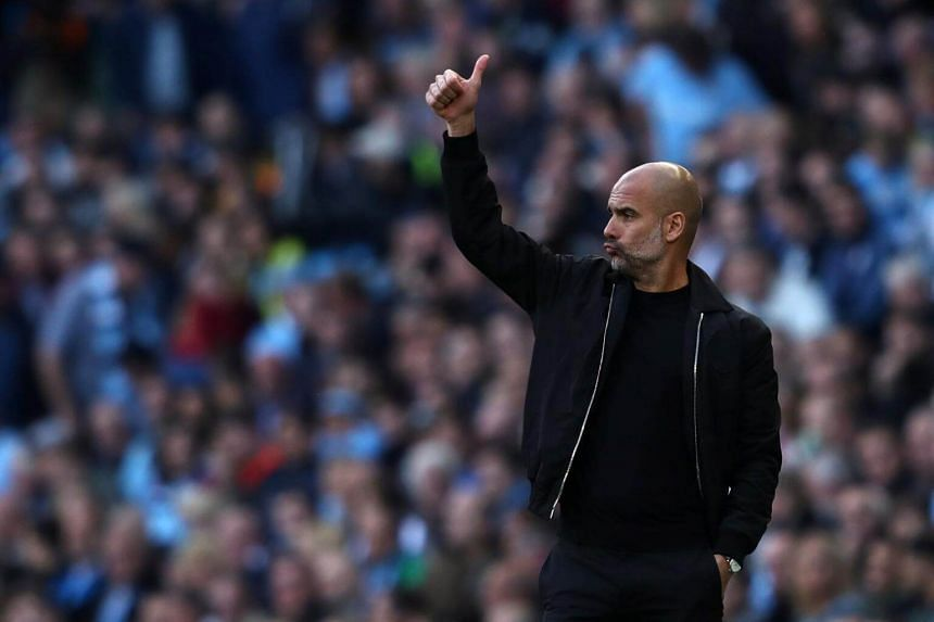 Manchester City manager Pep Guardiola gestures during their game against Brighton & Hove Albion at the Etihad Stadium in Manchester, on Sept 29, 2018.