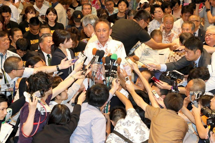 Mr Denny Tamaki speaks to reporters after winning the Okinawan gubernatorial elections in Naha, southern island of Okinawa, Japan, on Sept 30, 2018.