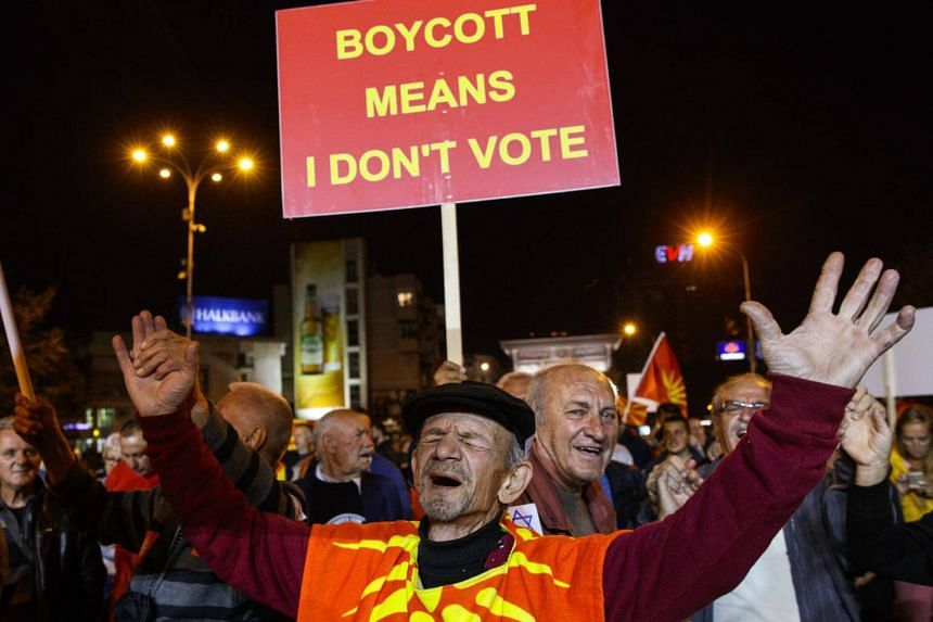 Opponents of the referendum celebrate the small response of voters in front of the Parliament building in Skopje, Macedonia, on Sept 30, 2018.