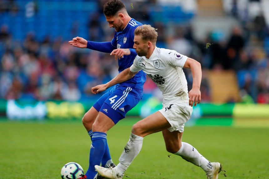 Cardiff City's Sean Morrison in action with Burnley's Charlie Taylor in Cardiff City Stadium, Cardiff, Britain, on Sept 30, 2018.