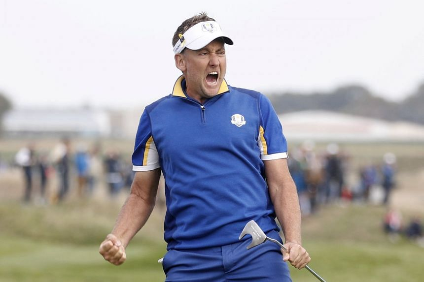 Ian Poulter of Team Europe celebrating making a birdie putt on the 14th green en route to a 2-up victory over world No.<TH>1 Dustin Johnson of the United States in their singles match on the final day of the Ryder Cup at Le Golf National in Paris yes