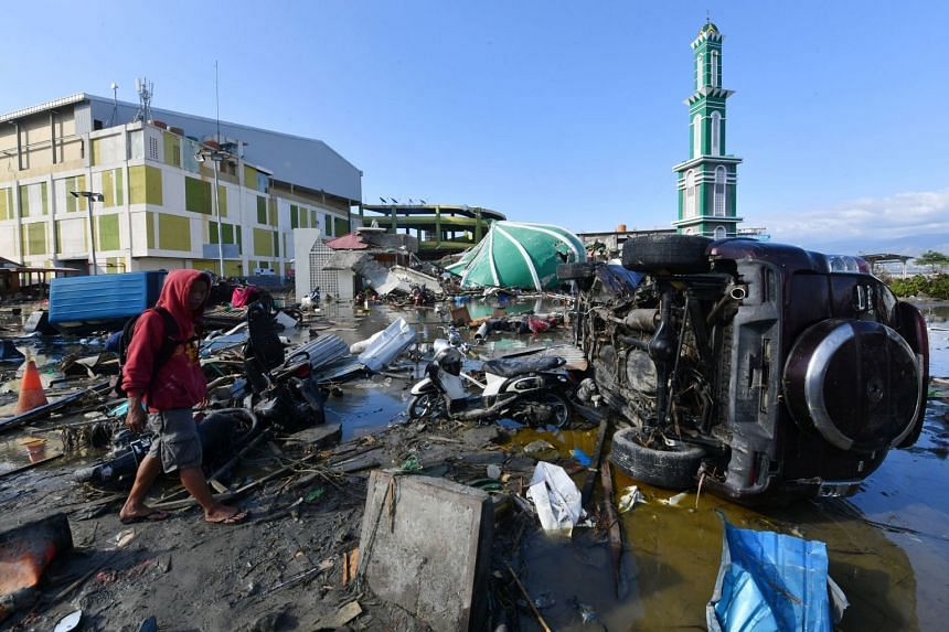 A scene of devastation in Palu after the earthquake. With the scale of the disaster still unclear, communication patchy and some areas still out of reach, families are posting photos, descriptions of lost family members and contact numbers on social