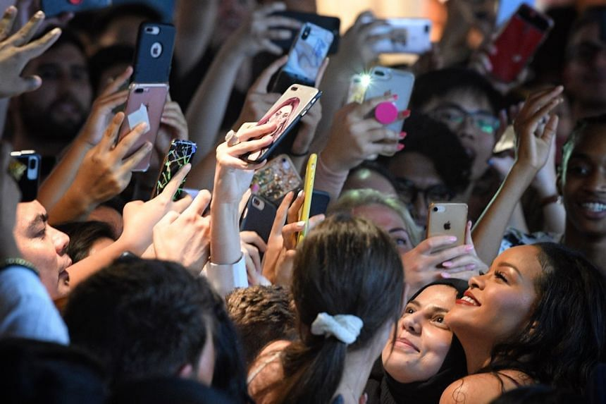 Rihanna poses for a quick selfie with her fans, at Sephora Ion Orchard, on Oct 1, 2018.