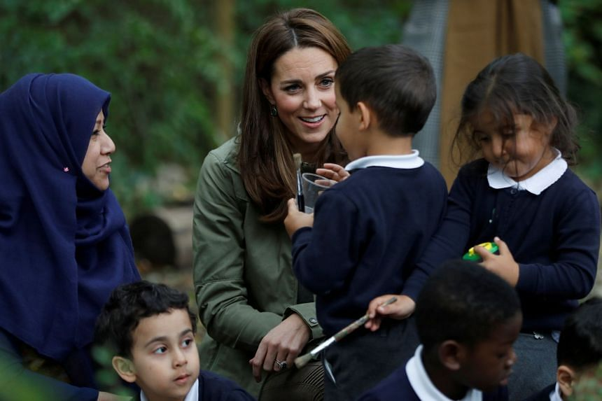 Katherine, Duchess of Cambridge interacts with children at Sayers Croft Forest School in London.
