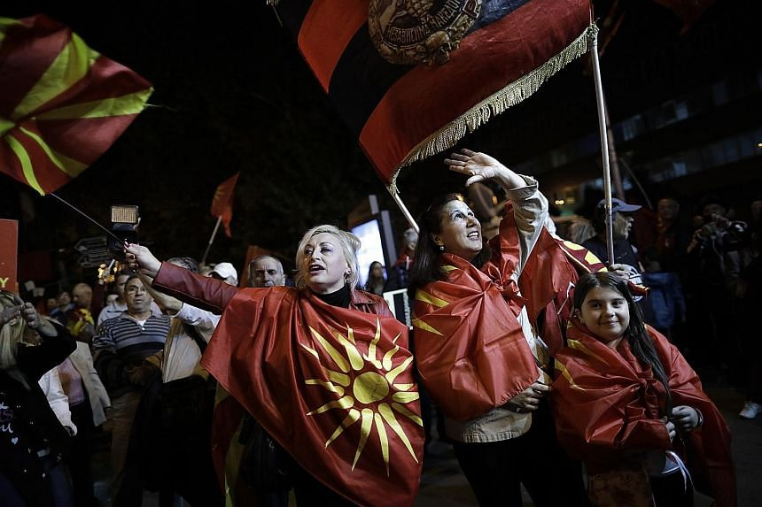 Opponents of the Macedonia referendum celebrating the small turnout of voters in the ballot on the country's name change.