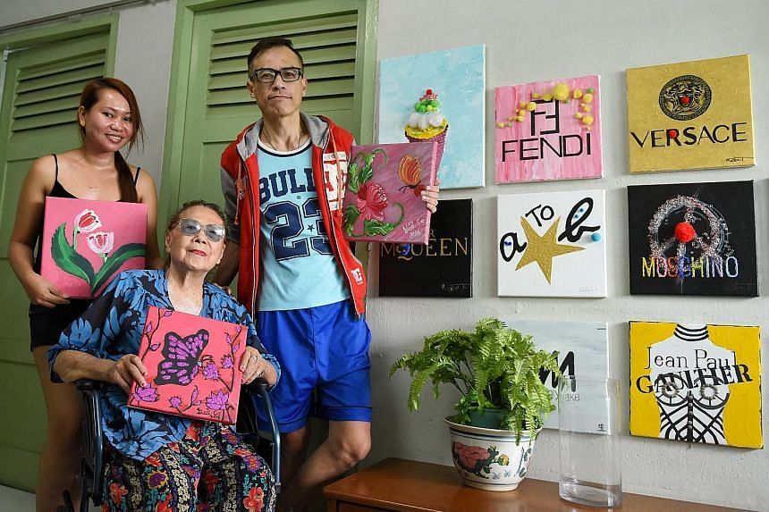 Accounting professional Daniel Lim (above left) with his parents, Madam Tan Quee Eng and Mr Peter Lim. The elder Mr Lim was diagnosed with dementia in 2009 and uses karaoke to help him connect with family and keep his brain alert. A group of senior c