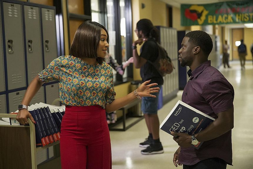 Night School, starring Tiffany Haddish and Kevin Hart (both left), earned about $38 million over the weekend.