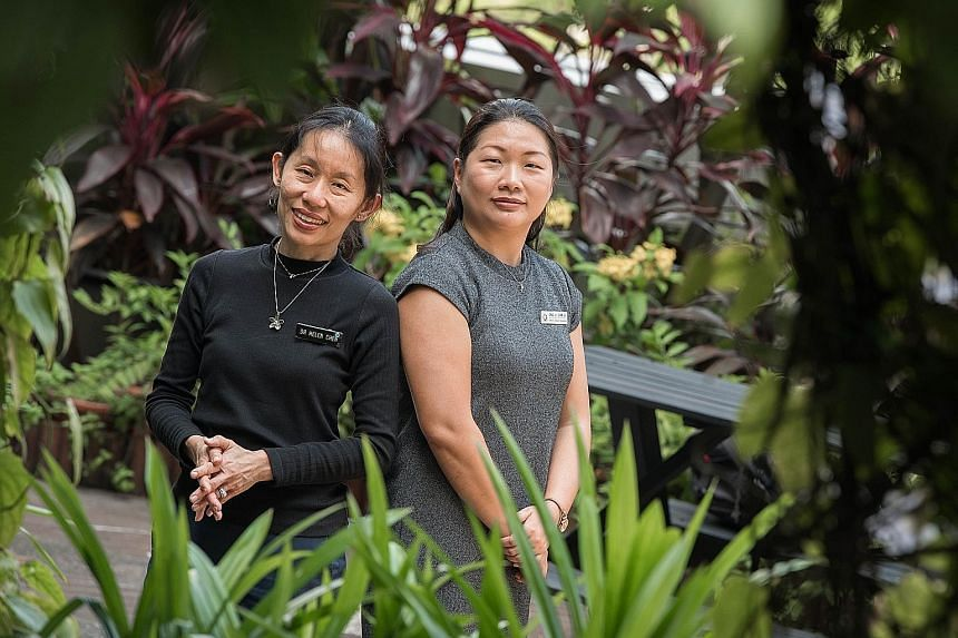 Ms Goh Sing Yee experienced post-natal depression when her first child was born in 2012. She eventually sought professional help at KKH. Dr Helen Chen (left), head of KKH's psychological medicine department, with Ms Ong Li Lian, a senior clinical cou