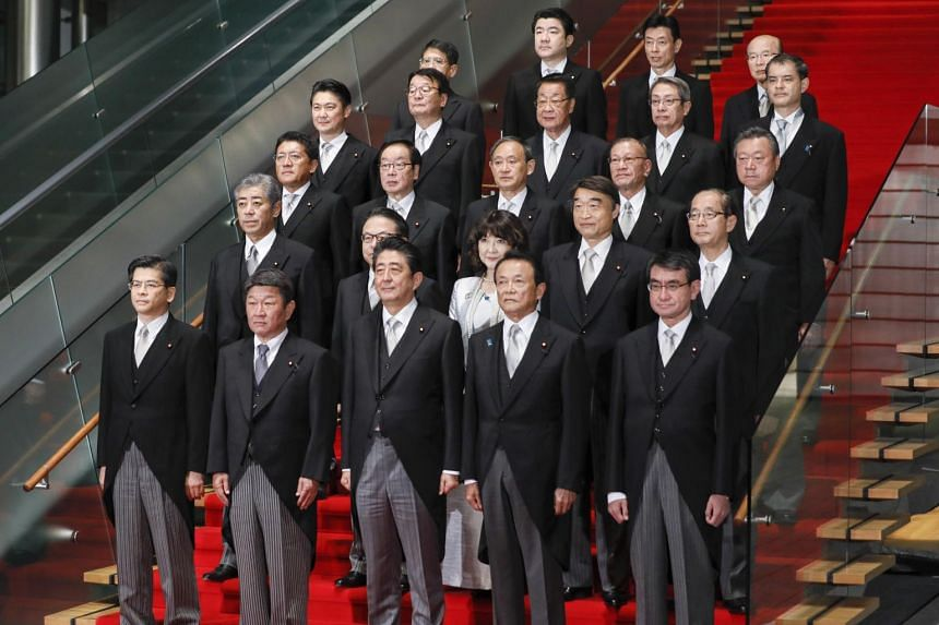 Japanese Prime Minister Shinzo Abe is  keeping his ministers in the key portfolios of finance, foreign affairs, economy and trade.