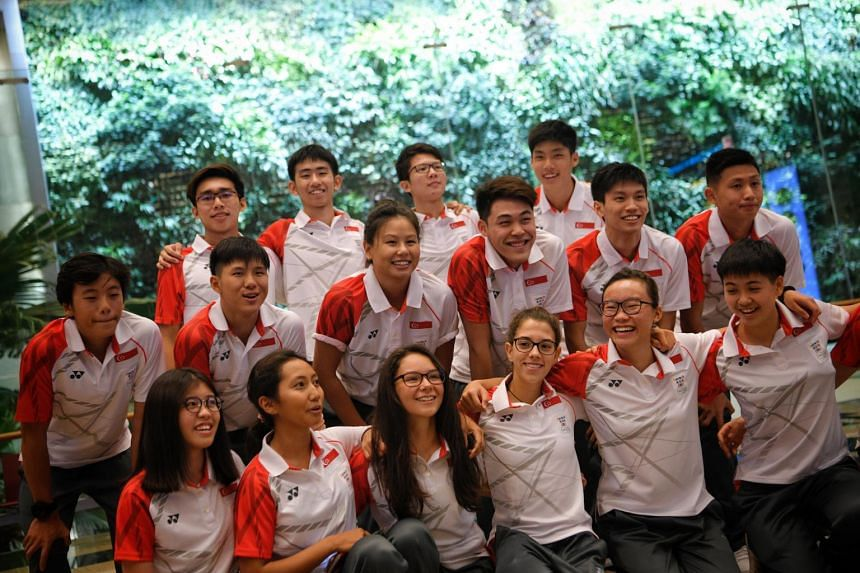 Singaporean athletes pose for a group picture during a send off for the Youth Olympic Games at Changi Airport Terminal 3, on Oct 2, 2018.