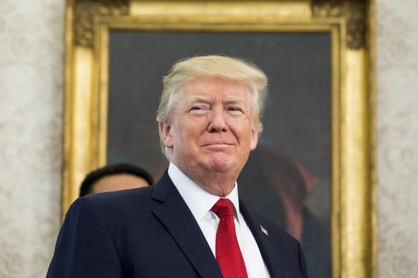 US President Donald Trump waits to speak about jobs, Nafta (the North American Free Trade Agreement), and the economy in the Oval Office of the White House in Washington, DC, US, on Oct 24, 2017.