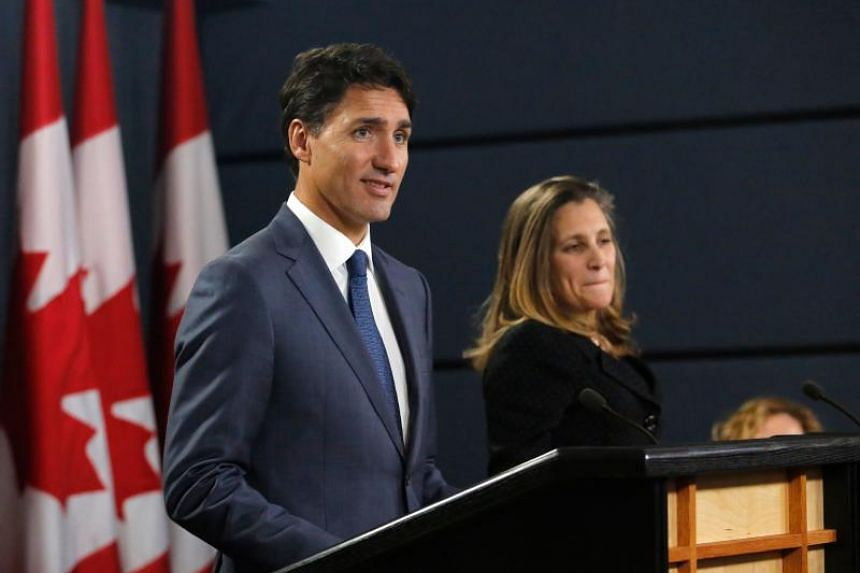 Canada's Prime Minister Justin Trudeau (left) and Minister of Foreign Affairs Chrystia Freeland speak at a press conference to announce the new USMCA trade pact between Canada, the United States, and Mexico in Ottawa, on Oct 1, 2018.