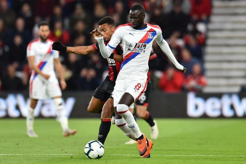 Bournemouth's English midfielder Junior Stanislas (left) vies with Crystal Palace's Senegalese midfielder Cheikhou Kouyate at the Vitality Stadium in Bournemouth, southern England on Oct 1, 2018.