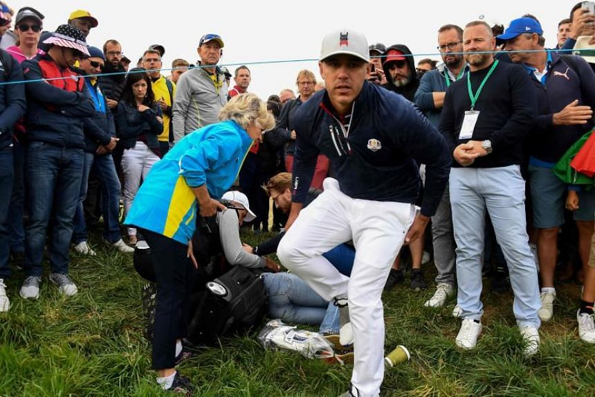 Brooks Koepka (right) made his way over to the crowd and apologised to the spectator after hitting her with a tee shot at the Ryder Cup.