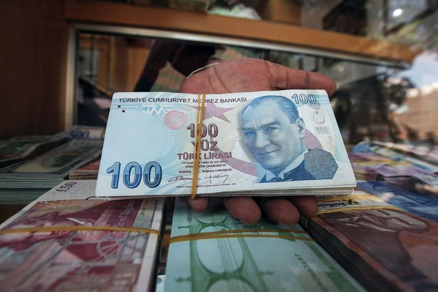 File photo of Turkish lira notes. The suspects had received commission for sending the money to 28,088 accounts abroad.