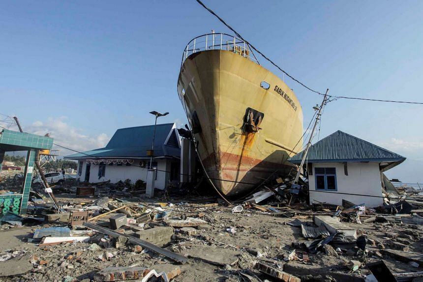 A ship is seen stranded on the shore after an earthquake and tsunami hit the area in Central Sulawesi, Indonesia, on Oct 1, 2018.