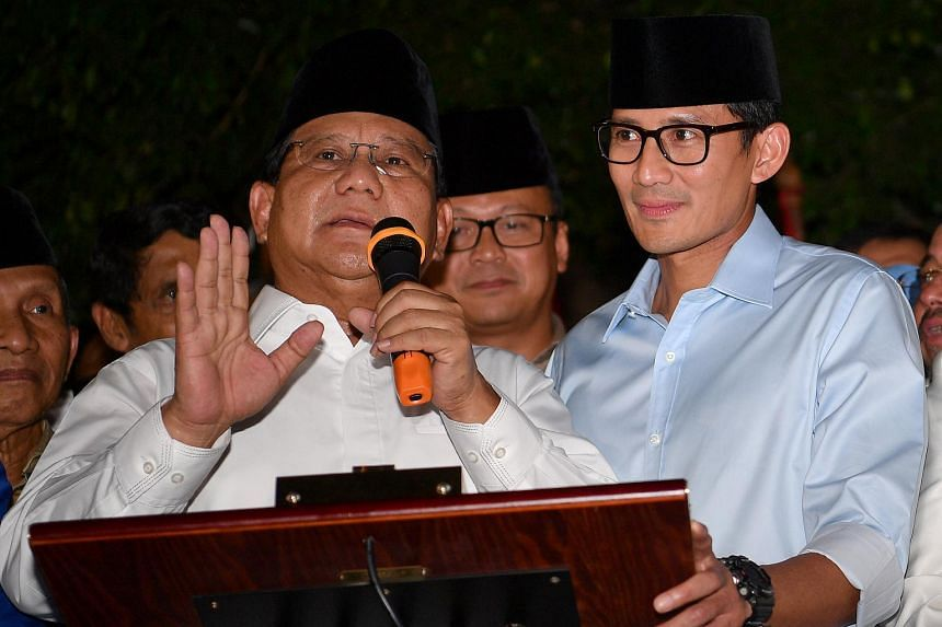 Presidential hopeful Prabowo Subianto (left) and his running mate Sandiaga Uno yesterday that their team will bring campaign activities to a temporary halt.