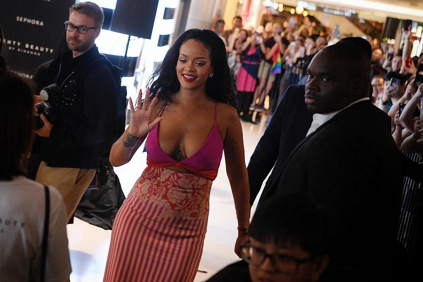 Rihanna greeting fans as she makes a surprise appearance at Sephora ION Orchard to celebrate the first anniversary of her beauty label Fenty Beauty, on Oct 1, 2018.