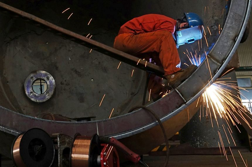 A steel worker at a plant in Dalian, Liaoning province. Two surveys from China on Sunday pointed to weakening in its manufacturing sector as domestic demand falters and US tariffs bite.