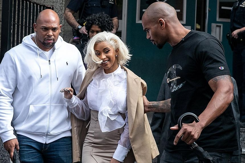 Rapper Cardi B leaving a police station in Queens, New York on Monday. She turned herself in after a brawl in a strip club.
