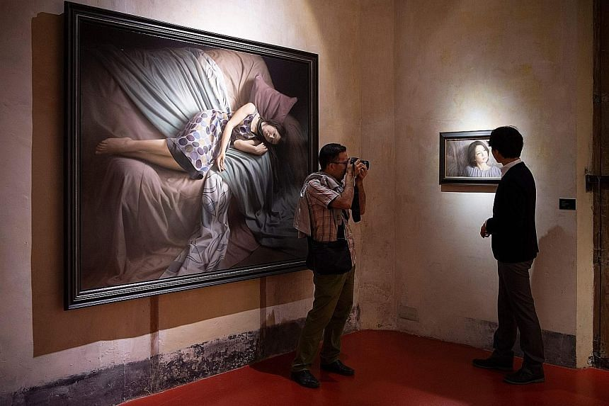 A visitor taking a photo at the exhibition, Contemporary Japanese Realism, at the European Museum of Modern Art in Barcelona last month.