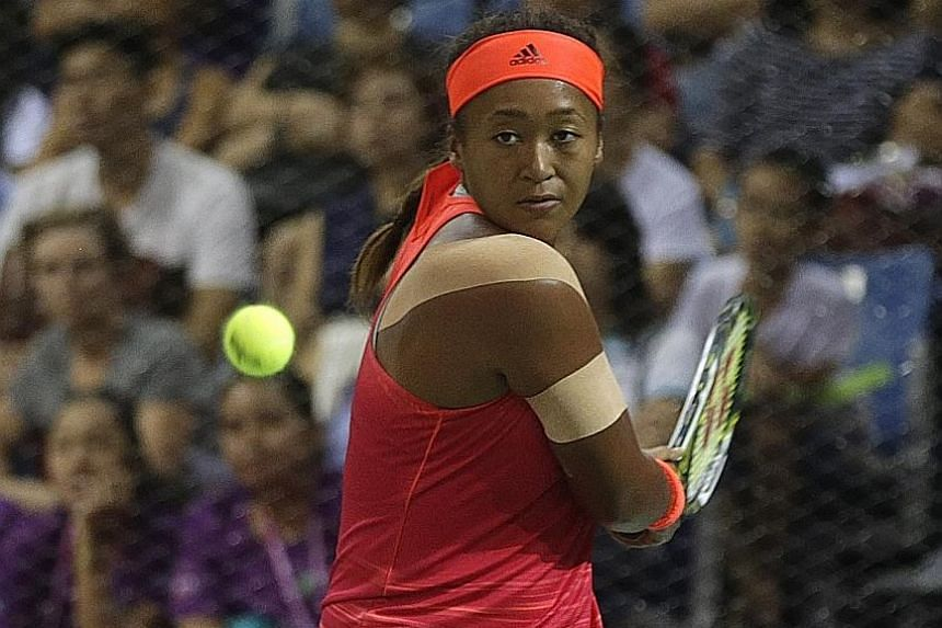 THEN: An 18-year-old Naomi Osaka on her way to beating China's Zhu Lin in their WTA Rising Stars round-robin match at the OCBC Arena in 2015. She upset France's Caroline Garcia to win the title. NOW: Reigning US Open champion Osaka in ruthless form y