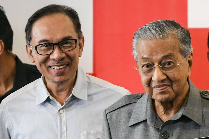 Malaysia Prime Minister Mahathir Mohamad (right) denied ever saying sorry to Mr Anwar Ibrahim, whom he sacked as deputy prime minister, and who was arrested for corrupt practices and sodomy in 1998.