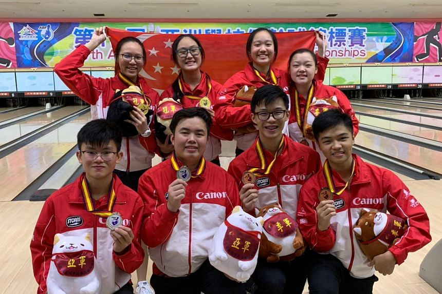Singapore's victorious bowlers (clockwise from top left) Alena Dang, Colleen Pee, Arianne Tay, Quek Lu Yi, Gerald Teng, Brandon Ong, Xavier Teo and Eugene Yeo, after their win at the 19th Asian School Tenpin Bowling Championships in Taipei on Oct 3,