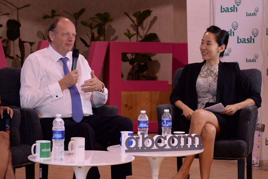 Dr Juliana Chan (right) at an event with Sir David Lane, chief scientist of the Agency for Science, Technology and Research. PHOTO: WILDTYPE MEDIA GROUP