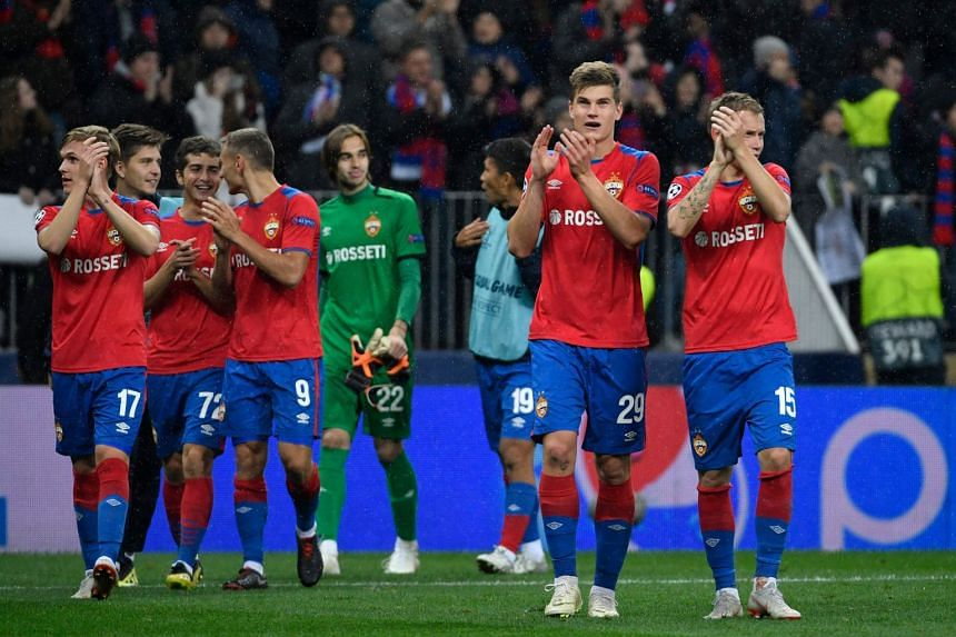 CSKA Moscow players applaud supporters after the match.
