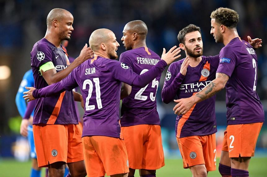 Silva and team mates celebrate after the match.