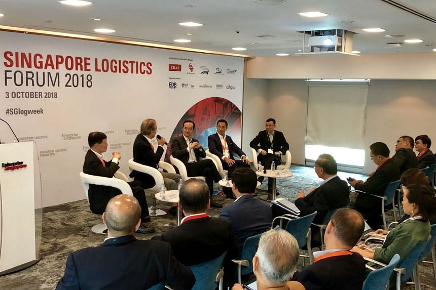 Dr Koh Poh Koon (middle) and logistics industry leaders at a panel discussion during the Singapore Logistics Forum 2018 on Oct 3, 2018.