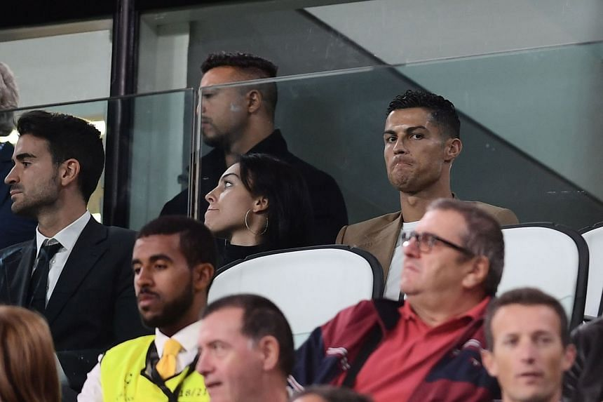 Ronaldo (right) and girlfriend Georgina Rodriguez (centre) watch Juventus play Young Boys in Turin, in Oct 2, 2018.