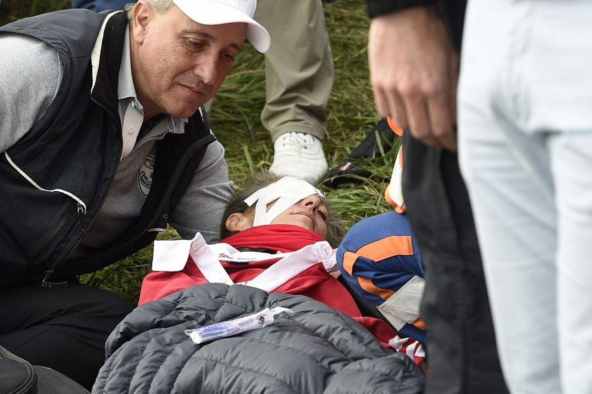 A girl receives medical assistance after she was hit by a ball during the 2018 Ryder Cup.