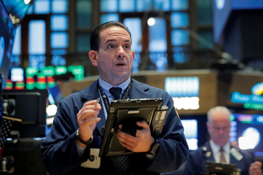Traders work on the floor of the New York Stock Exchange, Oct 3, 2018.