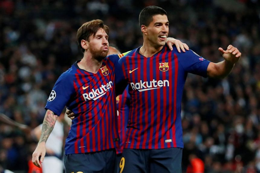 Barcelona's Lionel Messi celebrates with Luis Suarez after scoring their fourth goal.