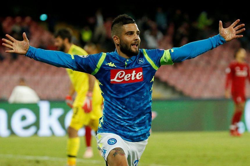 Napoli's Lorenzo Insigne celebrates scoring their first goal.