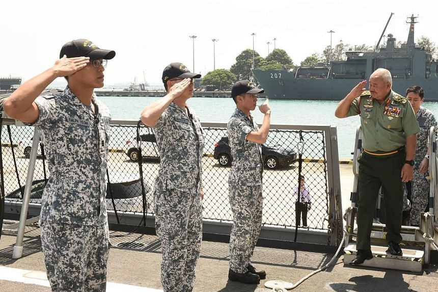 General Tan Sri Zulkifli Zainal Abidin boarding the RSS Steadfast during his visit to Changi Naval Base on Tuesday.