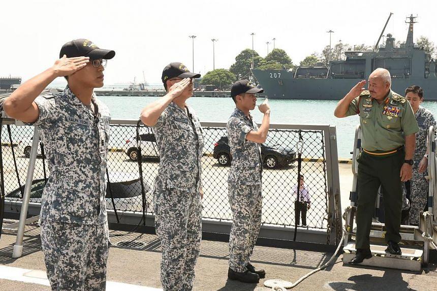 General Tan Sri Zulkifli Zainal Abidin boarding the RSS Steadfast during his visit to Changi Naval Base on Tuesday.