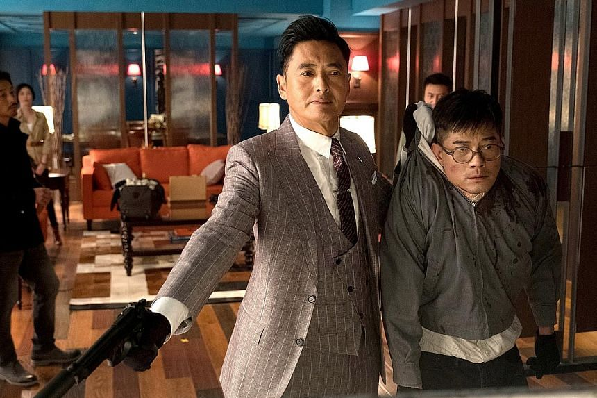 Project Gutenberg stars Chow Yun Fat (far left) and Aaron Kwok.