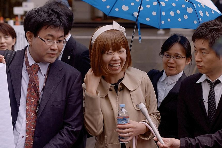 One of the cases featured in documentary Of Love And Law is that of artist Rokudenashiko (centre, with lawyer Kazu, far right), who was charged under Japan's obscenity laws.