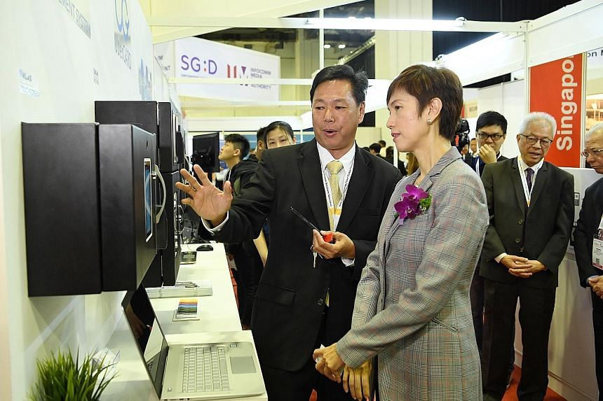 """Second Minister for Home Affairs Josephine Teo with uberGARD's general manager Tim Koh at the opening of the Security Industry Conference yesterday. Mrs Teo said there is also a need to move away from an """"output-based"""" contracting model, where buyers"""