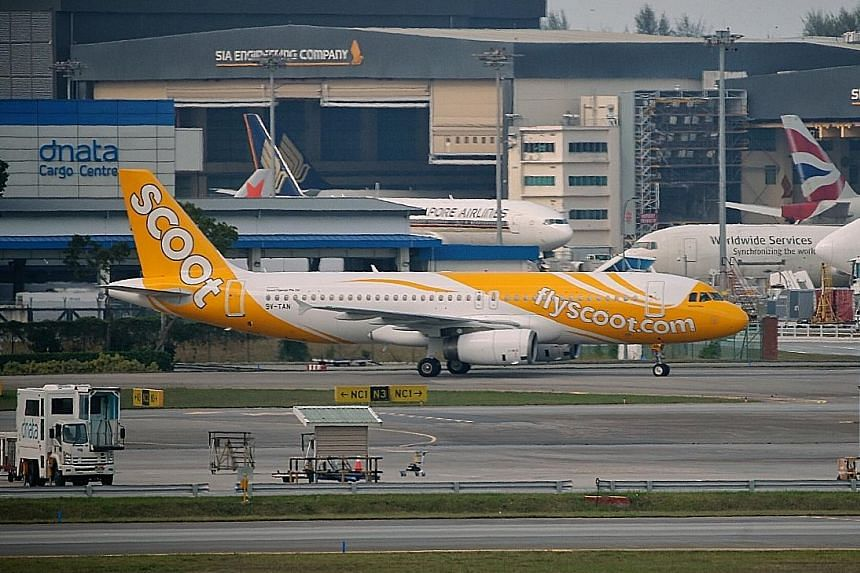 Above: One of the RSAF fighter jets that escorted Scoot Flight TR634 as it entered Singapore airspace on April 5, after passenger Hsu Chun Meng said he had a bomb in his bag. Left: The plane landed at a remote area away from the main Changi Airport t