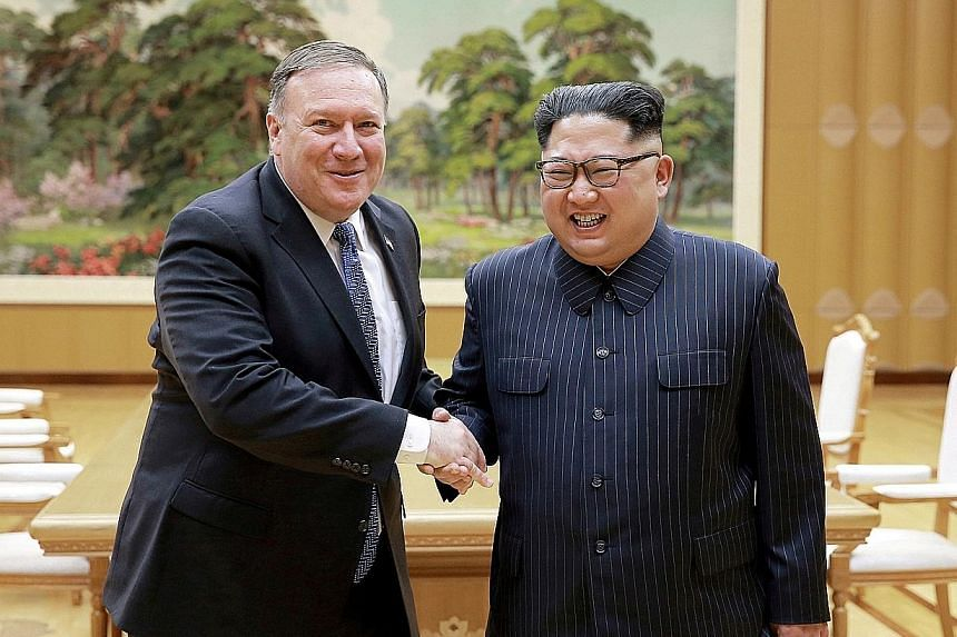 US Secretary of State Mike Pompeo (far left) meeting North Korean leader Kim Jong Un earlier this year. The US diplomat will be in Pyongyang on Sunday for another meeting with Mr Kim.