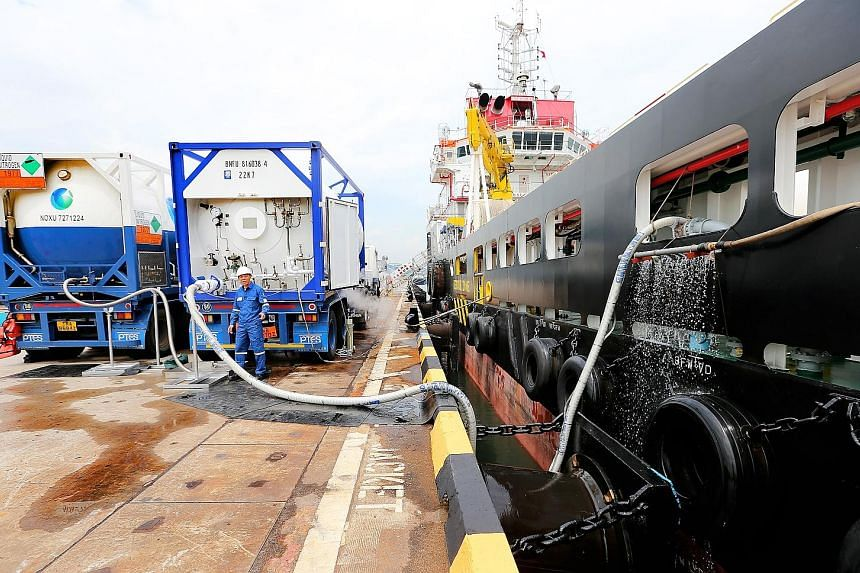 A truck-to-ship liquefied natural gas (LNG) bunkering at Jurong Port. The Maritime and Port Authority of Singapore co-funded the building of eight LNG-fuelled vessels to kick-start the use of the gas as a marine fuel.
