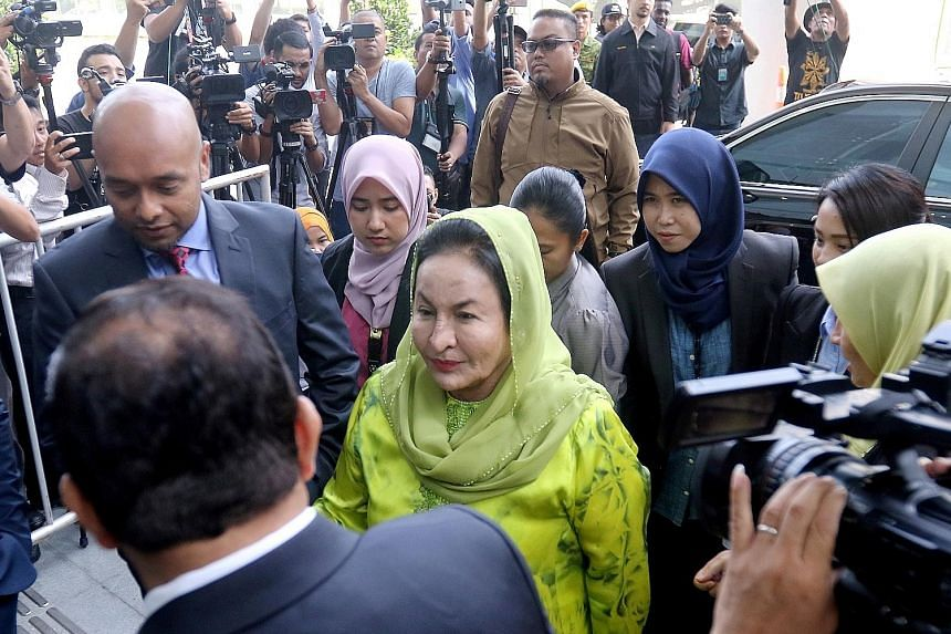 Madam Rosmah Mansor, the wife of former Malaysian prime minister Najib Razak, arriving at the Malaysian Anti-Corruption Commission headquarters in Putrajaya yesterday. It was her third visit to the anti-graft agency since June. She is expected to be
