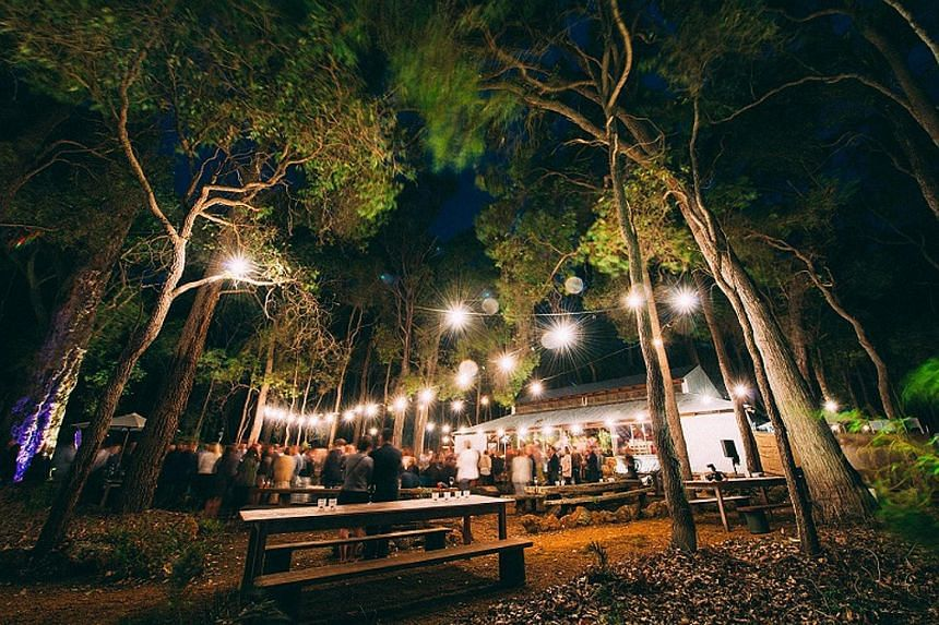 This year's Margaret River Gourmet Escape is headlined by celebrity chef Nigella Lawson (left) and includes events such as Feast In The Forest, set inside an old barn in the woods of Leeuwin Estate (above).