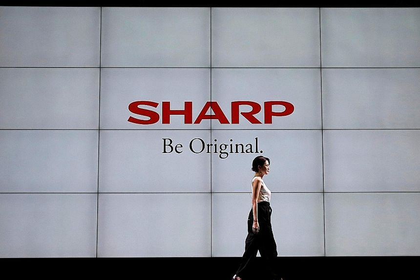 Sharp has said a shift from conventional LCD screens to more flexible Oled screens has been slower than expected due to high prices, making it cautious about near-term aggressive Oled capacity expansion.