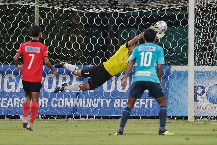 A free kick from Kenya Takahashi (not in picture) slipping through the fingers of Home United goalkeeper Kenji Rusydi during the second leg of the RHB Singapore Cup semi-final at Bishan Stadium yesterday. The goal gave Singapore Premier League champi